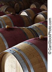 Wine barrels - Oak wine barrels in a modern winery,...