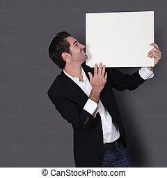 Funny salesman holding whiteboard
