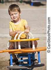 toddler having fun - boy toddler is having fun in the...