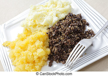 Haggis tatties and neeps - A traditional Scottish haggis...