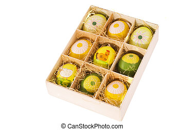 isolated box with eastereggs - wooden box with colored...