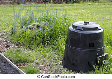 Garden Compost Bin and Pile - Black plastic compost bin in...