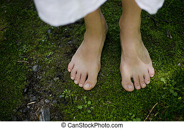 Connection - A young girl's bare feet feeling the softness...