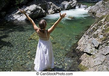 Adoration - Beautiful young woman enjoying the purifying...