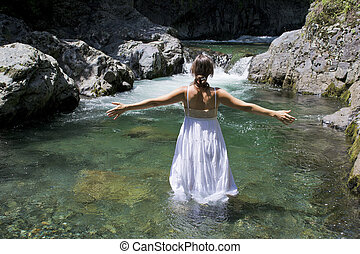 Perfection - Beautiful young woman enjoying the purifying...