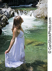 Purity - Beautiful young woman enjoying the purifying waters...