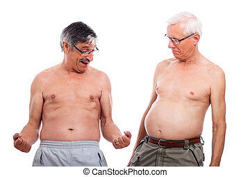 Seniors compare body shape - Two happy naked senior men...