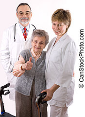 Helping Hand - Health care workers and elderly woman needs...