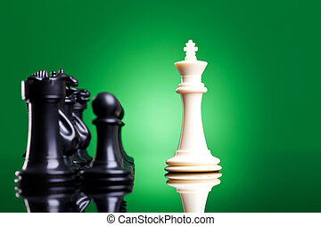 white king in front of the black chess pieces