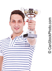 young man winning the first place trophy at a competition,...