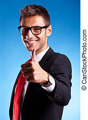 Business man shows thumbs up ok gesture