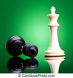 the defeated white king is down - Black and white chess...