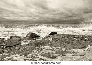 Waves breaking on a rocky coastline