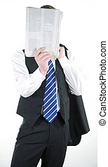 Relaxed businessman reading a newspaper
