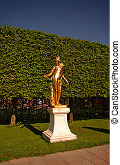 A golden statue of Madona in Schwetzingen Garden