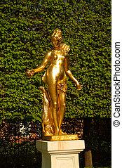 A golden statue of Madona in Schwetzingen Garden