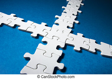 Cross-shaped jigsaw puzzle. - White plain jigsaw puzzle in...