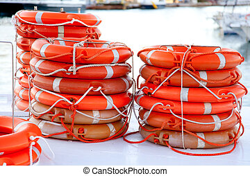 Buoys round lifesaver stacked for boat safety equipment