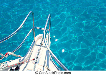 Balearic blue clean turquoise water from boat bow high angle...
