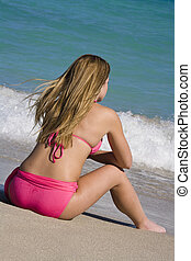 Beach - Beautiful Caucasian female teenage sitting in the...