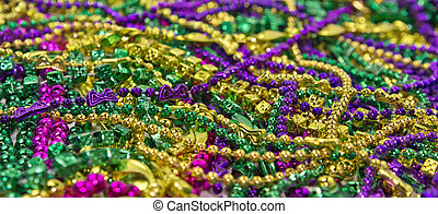Mardi Gras Beads & Coins - Backgroun of colorful Mardi Gras...