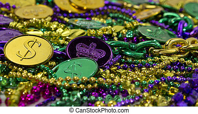 Mardi Gras Beads & Coins - Colorful Mardi Gras beads & coin...