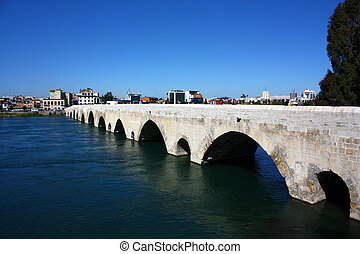 Bridge of Adana - Old bridge made of stone on the river.
