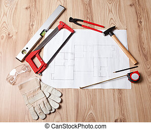 Carpenter tools and building plan - Photo of carpenter tools...