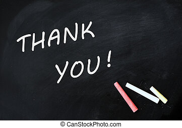 Thank you written with chalk on a smudged blackboard - Thank...