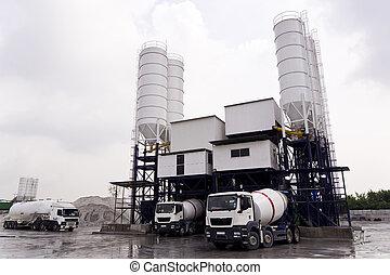 Concrete Mixing Factory - Trucks loading at a Concrete...