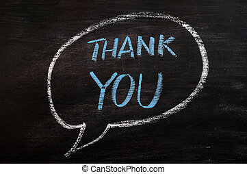 Thank you written with blue chalk on a smudged blackboard -...