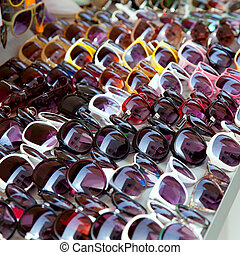 Fashion sunglasses rows in outdoor shop display pattern