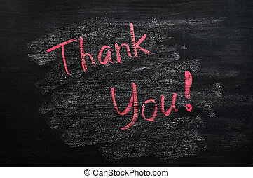 Thank you written with red chalk on a smudged blackboard