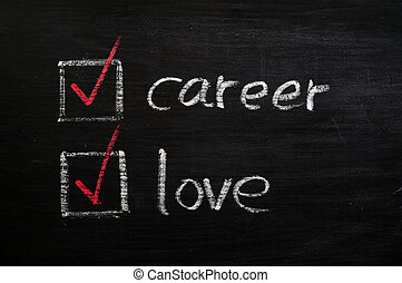 Love and career choices with check boxes on a blackboard -...