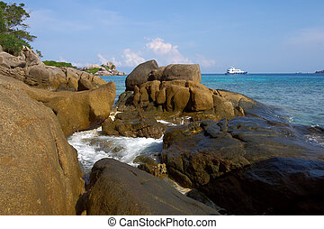 Coastal cliffs and beaches of the Similan Islands in...
