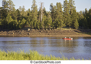 Lake Fishing - fishermen in a boat on a scenic mountain lake
