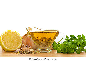 salad dressing with olive oil, garlic and lemon