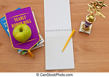 school awards and empty notebook