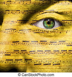 Face with eye showing sheet music as Beethovens 5th Symphony...