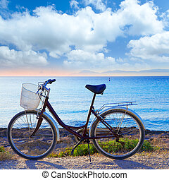 Bicycle in formentera beach with Ibiza sunset - Bicycle in...