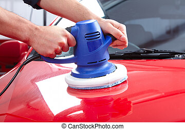 Auto polisher - Hands with Auto polisher Car repair service...