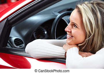 Young beautiful woman in the car.