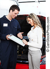 Auto mechanic and a client woman Car repair service