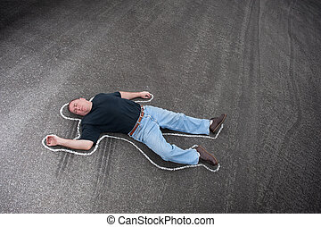 Chalk line and man - A man dead in the street outlined with...