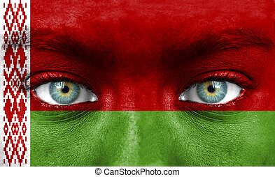Human face painted with flag of Belarus