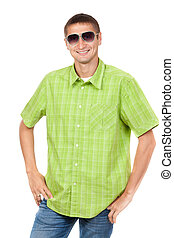 Portrait of a man aged 25 years, wearing sunglasses in a plaid shirt, green studio isolated on white background