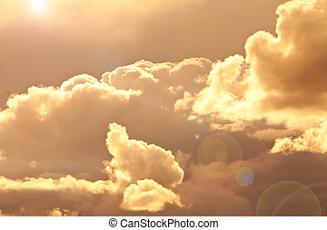 Golden Sunset - sky and clouds in a warn golden color