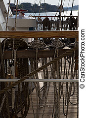 Detail of old ship - Ropes on a ship early in the morning in...