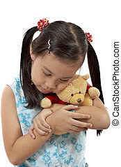 girl with a teddy bear over a white background