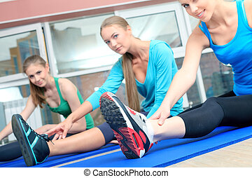 fitness - Group of sportive young women in the gym centre